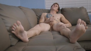 Athletic handsome guy jerks his big cock