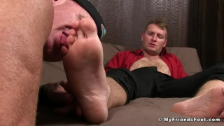 blond guy can't believe this dude is sucking his big toe