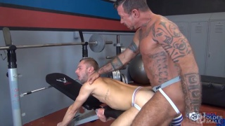 inked daddy raw fucks dirty jock in gym