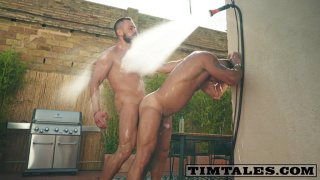 beefy men fuck in an outdoor shower