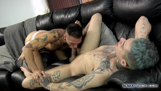 inked buddy gets sucked and fucked on the couch