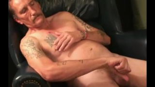 redneck daddy with mustache jerks his cock