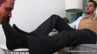 personal assistant worships his boss's feet