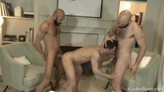 two bald & bearded men share a bottom's ass