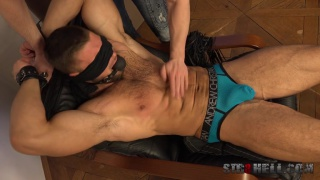 gorgeous hunk bound and blindfolded in spanking session