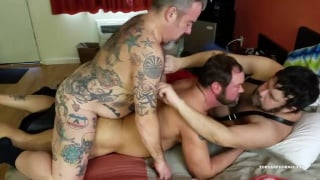 heavily-inked top fucks two hairy men in threeway