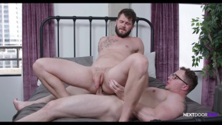 bearded hunk rides bespectacled guy's dick