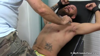beard straight guy strapped into the tickling chair