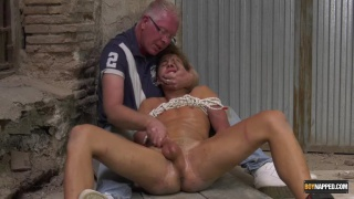 young lad cradled in old man's arms get his cock edged