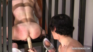 master lubicrates large dildo in his slave's throat