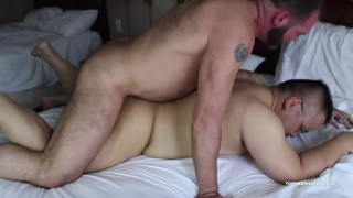 hairy daddy fucks bespectacled chubby boy's ass