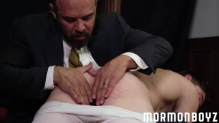man in suit takes naked mormon boy over his knee