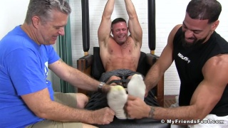 guy's big toes are tied together for tickling session