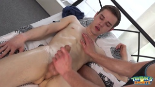 young twink oiled up on the massage table and stroked off
