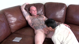 heavily inked bald stud gets head from a guy