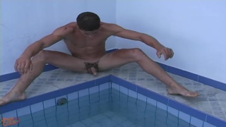 ripped papi stroking dick by the pool