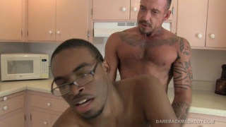 inked daddy bends his boy over the kitchen counter