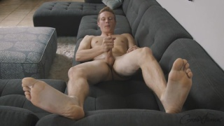 muscled blond stud strokes his hard dick