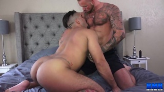 muscle hunk lies back while horny bottom rides his dick