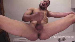 scruffy-faced latino strokes his thick uncut cock