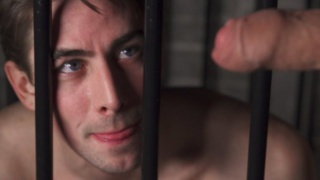caged cocksucker begs for his captor's meat