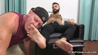 sexy bearded hunk gets his feet worshipped