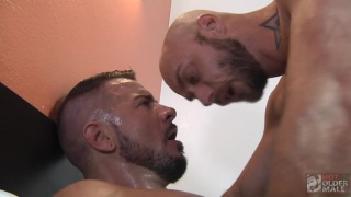 bearded muscle stud rides a hairy inked daddy's dick