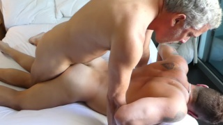two daddies fuck a tatted muscle man