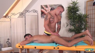 beefy blond masseur gives client a happy-ending massage