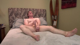 guy's cock becomes hard as a rock as he strokes