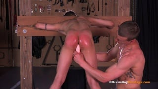 slave boy is bent over and locked in the pillory