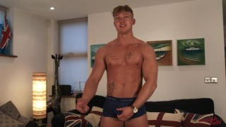 young rugby player plays with his cock