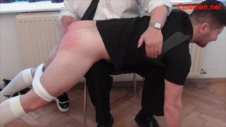 beefy rugby player goes over spanker's knee