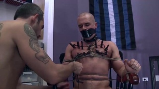 daddy straps his slave boy to a wooden chair