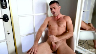 lnace hart admires himself in a mirror while jacking off