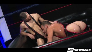 hunky guys wrestle out of their singlets and fuck