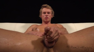 blond guy strokes his uncut dick