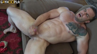gigantic muscle hunk jerks his cock
