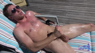 aussie plays with his cock in the summer sun