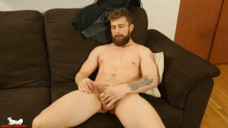 bearded muscle hunk jerks his uncut dick