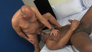 bald daddy throat fucks a black bottom stud