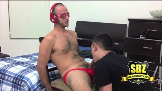 straight guy in red underwear sits on bed and gets blowjob