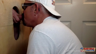 daddy with handlebar mustache sucks dick at glory hole
