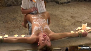 young lad bound and covered with hot wax gets his cock milked