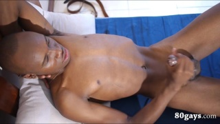 african guy plays with his boner in bed