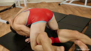 wrestler has a hard time pinning the other to the mats