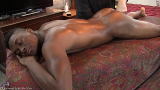 muscled black dude gets his butt fingered on massage table