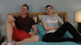 two guys wank one another's big uncut cocks