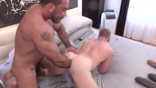 muscle hunk buries his hand in this bottom's ass