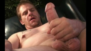 masculine guy with face scruff jerks his delicious cock
